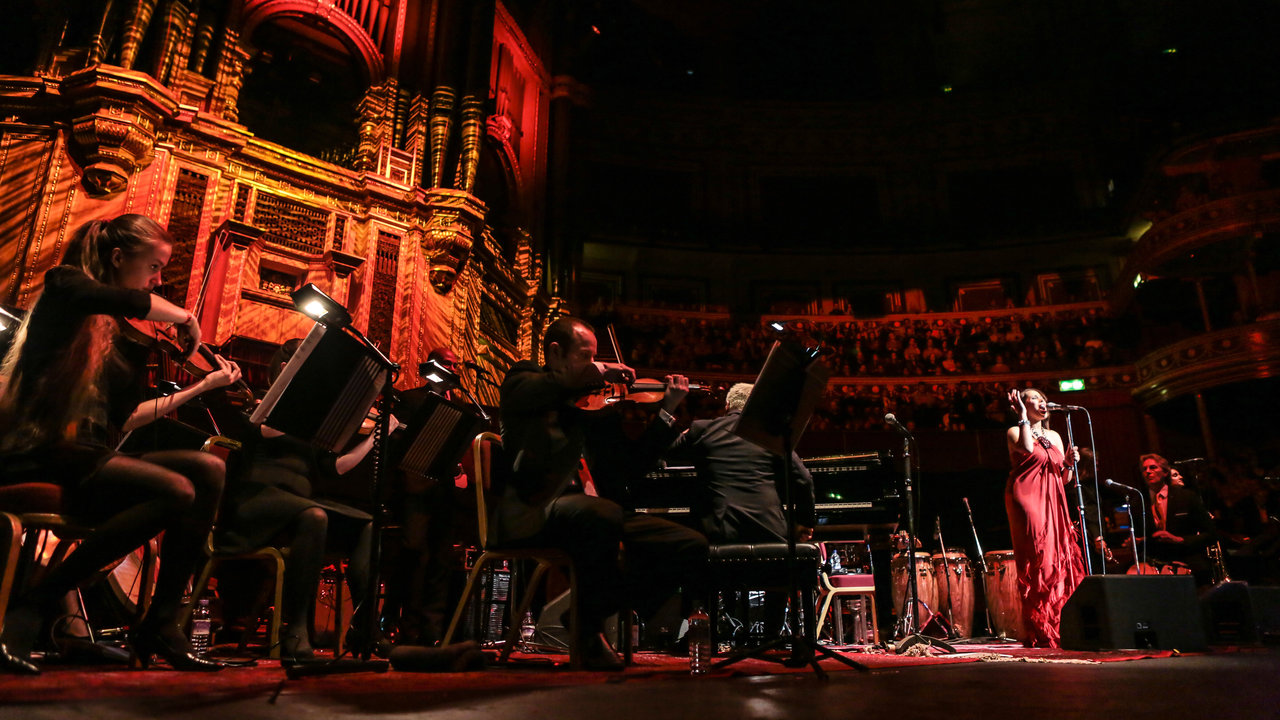 Pink Martini performing live on stage at the Royal Albert Hall.