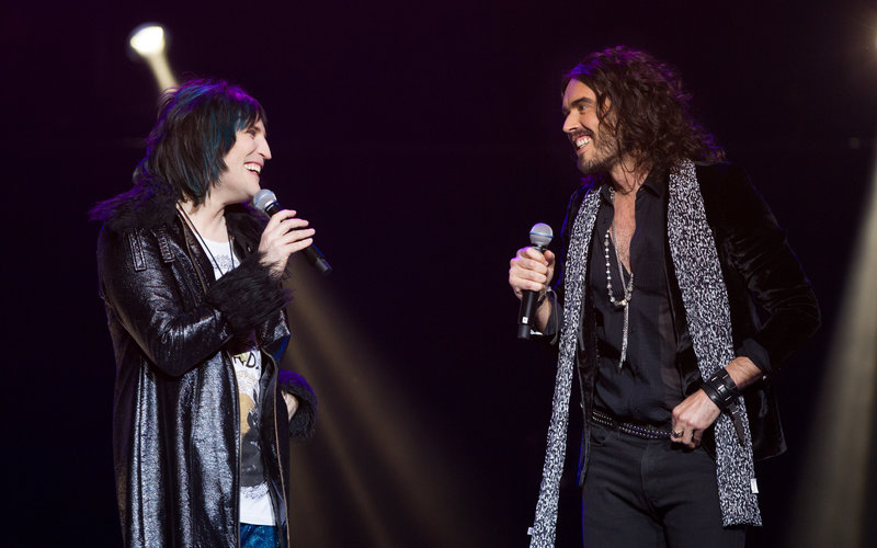 Comedians Russell brand and Noel Fielding live on stage at the Royal Albert Hall during the Teenage Cancer Trust series in 2013