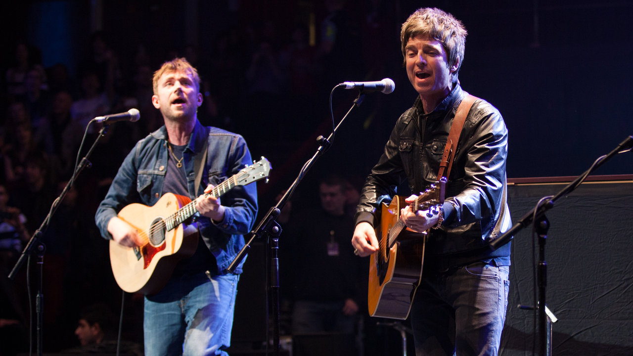 Damon Albarn and Noel Gallagher performing on stage during the Teenage Cancer Trust series at the Royal Albert Hall.