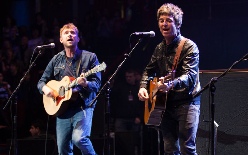 Damon Albarn and Noel Gallagher performing on stage during the Teenage Cancer Trust series at the Royal Albert Hall in 2013