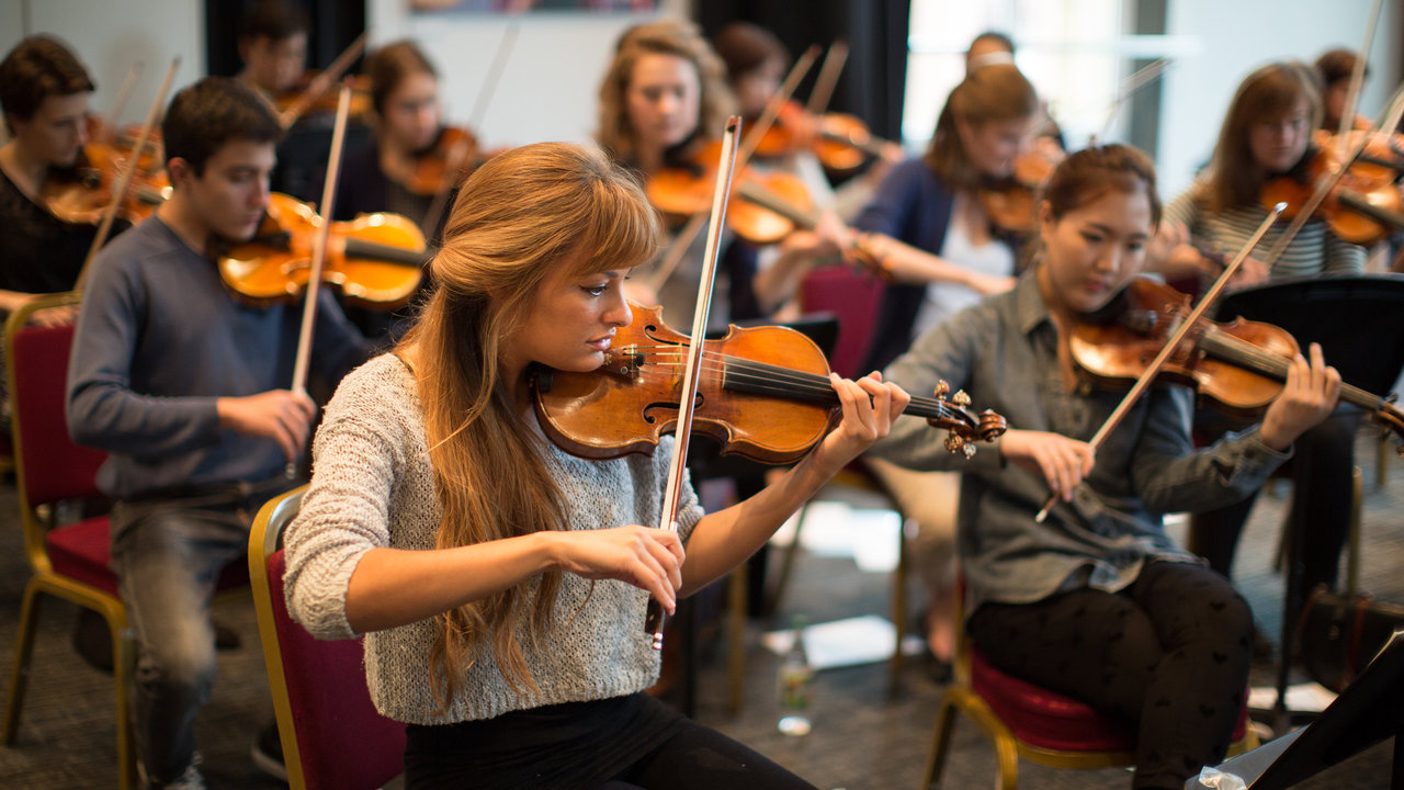Nicola Benedetti at the Royal Albert Hall rehearsing with string players from the Royal College of Music (RCM) and the Royal Academy (RA) ahead of their performance on Saturday as part of the Hall's Education programme.