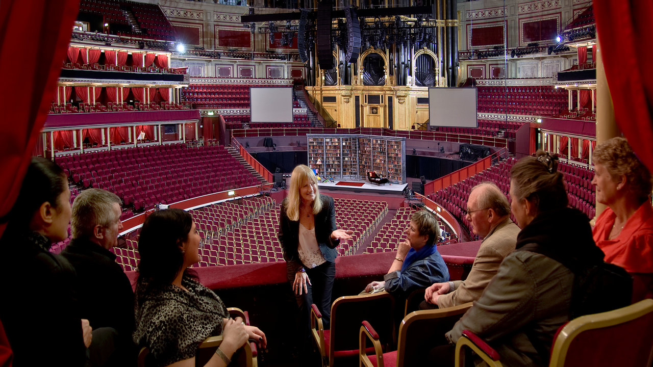 Tour guide leading a tour of the Royal Albert Hall.