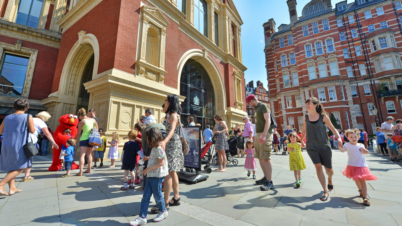 Families outside the Royal Albert Hall for Prom 11 (CBeebies) of the 2014 BBC Proms.