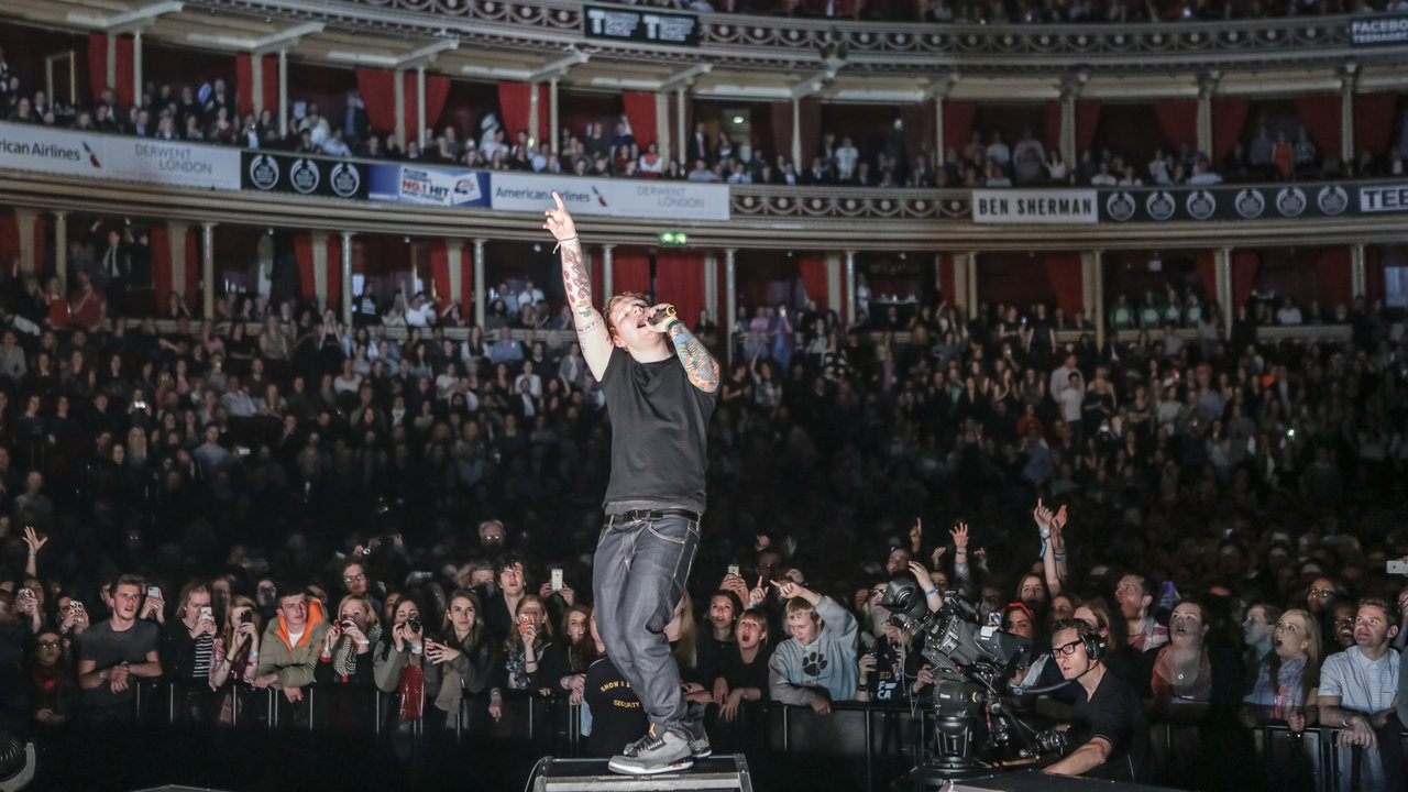 Ed Sheeran performing on stage during the Teenage Cancer Trust Concert Series at the Royal Albert Hall.